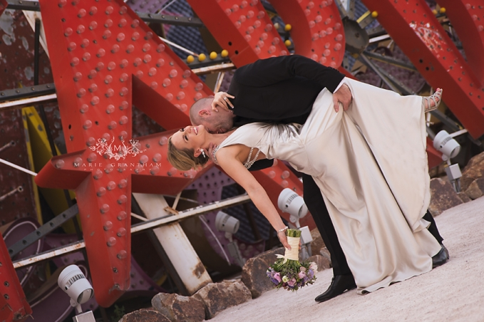 classy bride being dipped down for a kiss during bridal portrait session with marie grantham photography in las vegas